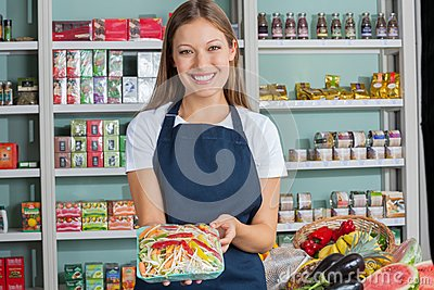 Woman Holding Vegetable Packet In Supermarket