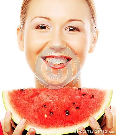 Woman holding watermelon ready to take a bite