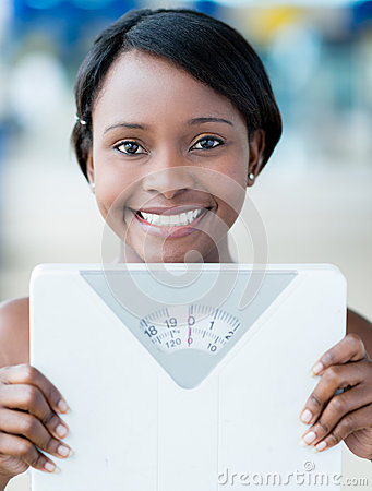 Woman holding weight scale