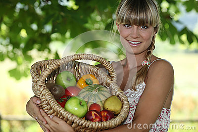 Woman holding wicker basket