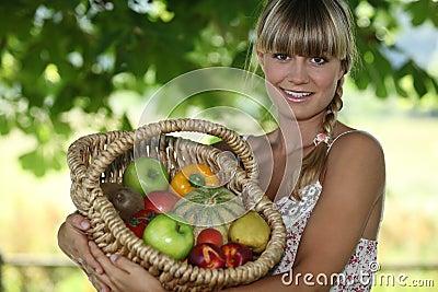 Woman holding wicker basket