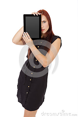 Free Woman Holds A Tablet Computer Over Half Of Her Face. Stock Photo - 31903630