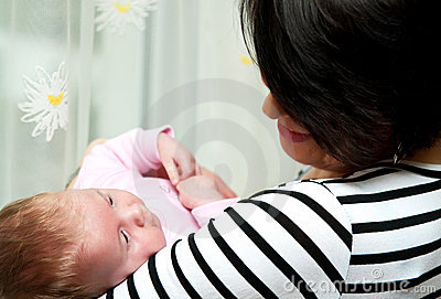 Woman holds baby