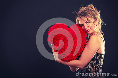 Woman holds big red heart love symbol Stock Photo