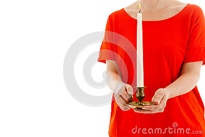 The woman holds a candle in hands