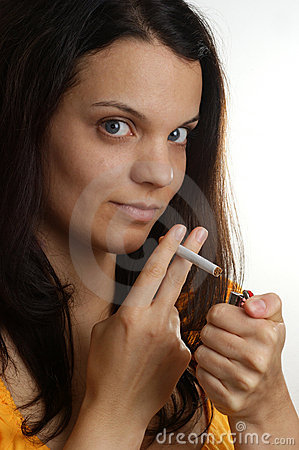 woman holds a cigarette in her finger