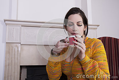 Woman holds a cup of coffee
