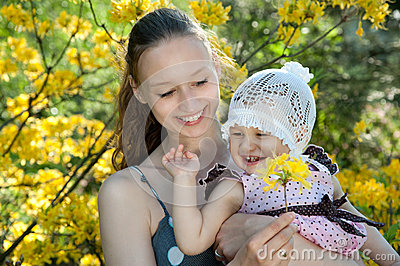 Woman holds daughter