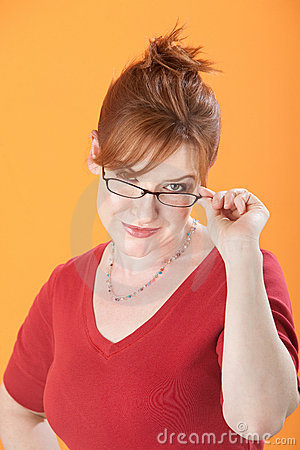 Woman Holds Eyeglasses
