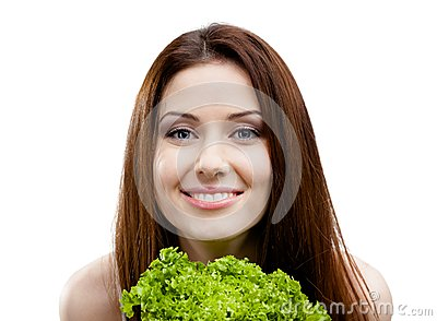 Woman holds fresh lettuce leaves