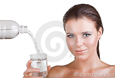 Woman holds a glass of water