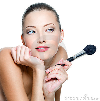 Woman holds make-up brushe for applying  rouge