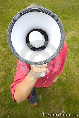 Woman holds megaphone