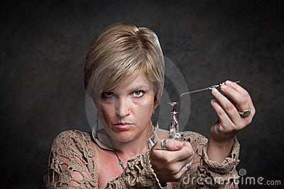 Woman Holds Potion Bottle