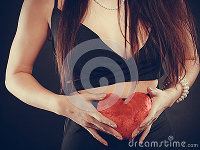 Woman holds red heart love symbol Stock Photo