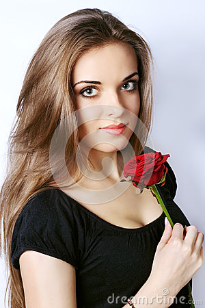 Woman holds a red rose