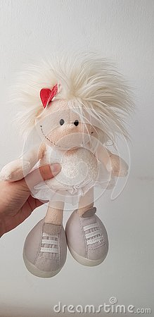 Woman holds a soft angel toy Stock Photo