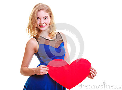 Woman holds Valentine day symbol love heart Stock Photo