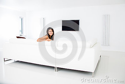 Woman at home watching tv
