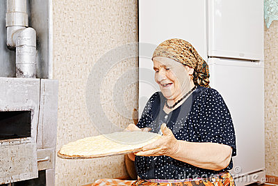 Woman with homemade bread
