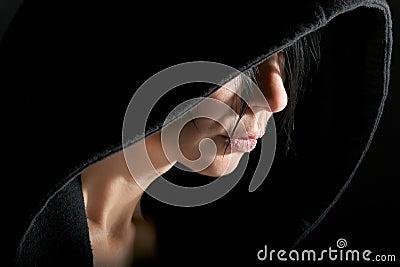 Woman in hood in dark