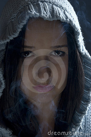 Woman with hood in smoke