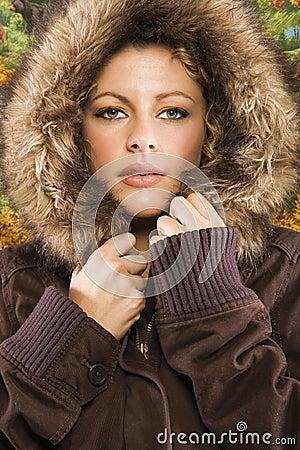 Woman in hooded coat.