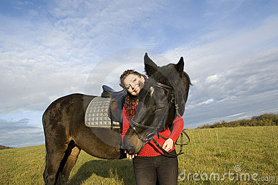 A woman and a horse.