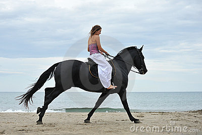 Woman and  horse on the beach