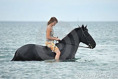 Woman and  horse in the sea