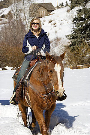 Woman horseback riding.