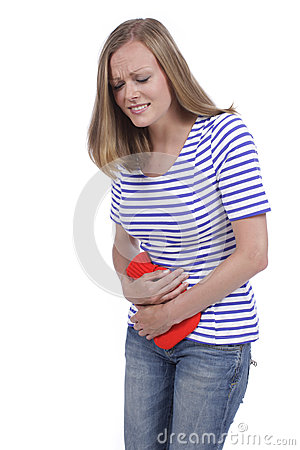 Woman with hot bottle and stomach pain