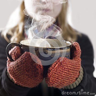 Woman and hot steaming cup
