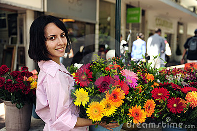 Woman with huge bouquet  of  flowers outdoors