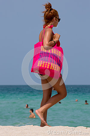 Woman with huge pink Bag surf style in miami beach
