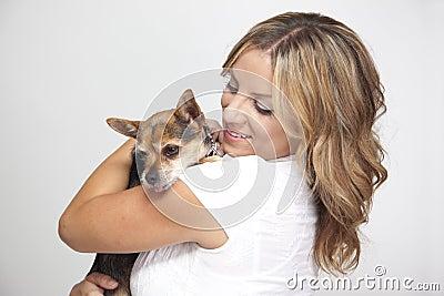 Woman hugging pet dog
