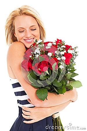Woman hugging roses