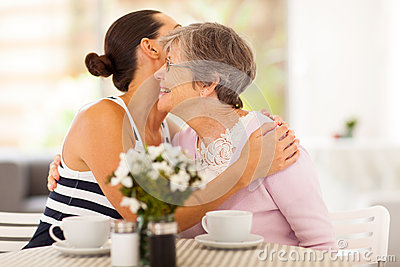 Woman hugging senior mother