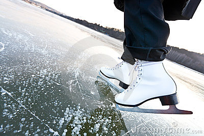 Woman ice skates with overview