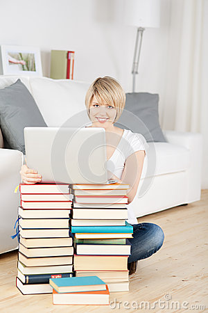 Woman improvising using books as a table