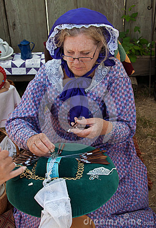 Free Woman In 19th Century Costume Making Bobbin Lace Royalty Free Stock Photography - 25932067