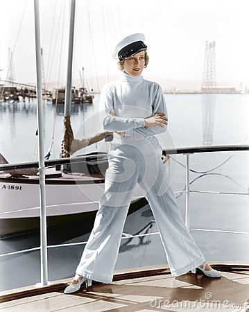 Free Woman In A Captains Hat Standing On Top Of A Sailboat Stock Photo - 52015690