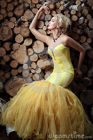 Free Woman In A Dress On Background Of Firewood. Stock Photo - 75850980