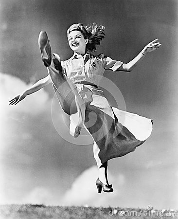 Free Woman In A Flowing Dress Leaping Through The Air Royalty Free Stock Photography - 52030177