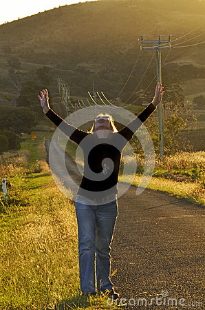Free Woman In Beautiful Countryside Raising Arms To Thank God For Answered Prayer Stock Photography - 93074522