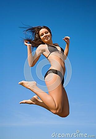 Free Woman In Bikini Jumping High Royalty Free Stock Photography - 10801817