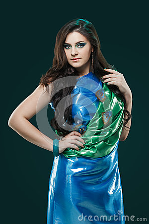 Free Woman In Brilliant Blue-green Dress With Peacock Feathers Design. Creative Fantasy Makeup, Long Dark Hair. Royalty Free Stock Photo - 67133525