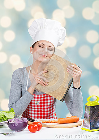 Free Woman In Chef S Hat With The Old Grandmother S Cookbook Stock Photos - 32533823