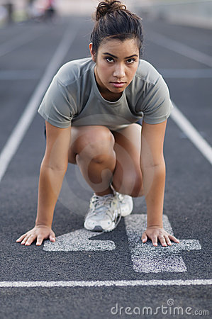 Free Woman In Crouching Position At Start Of Race. Royalty Free Stock Photo - 10541435