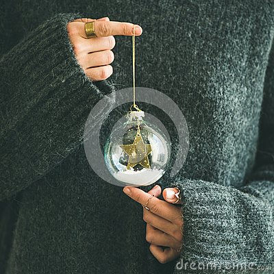 Free Woman In Grey Sweater Holding Decorative Glass Ball, Square Crop Royalty Free Stock Photography - 105795057